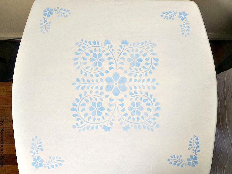 Using the white decorative wax to finish the table top, How to Give your Old Table a New Look with Stencils, the boondocksblog.com