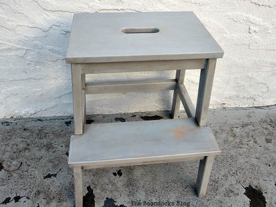 An Ikea Stool aged with paint and wax