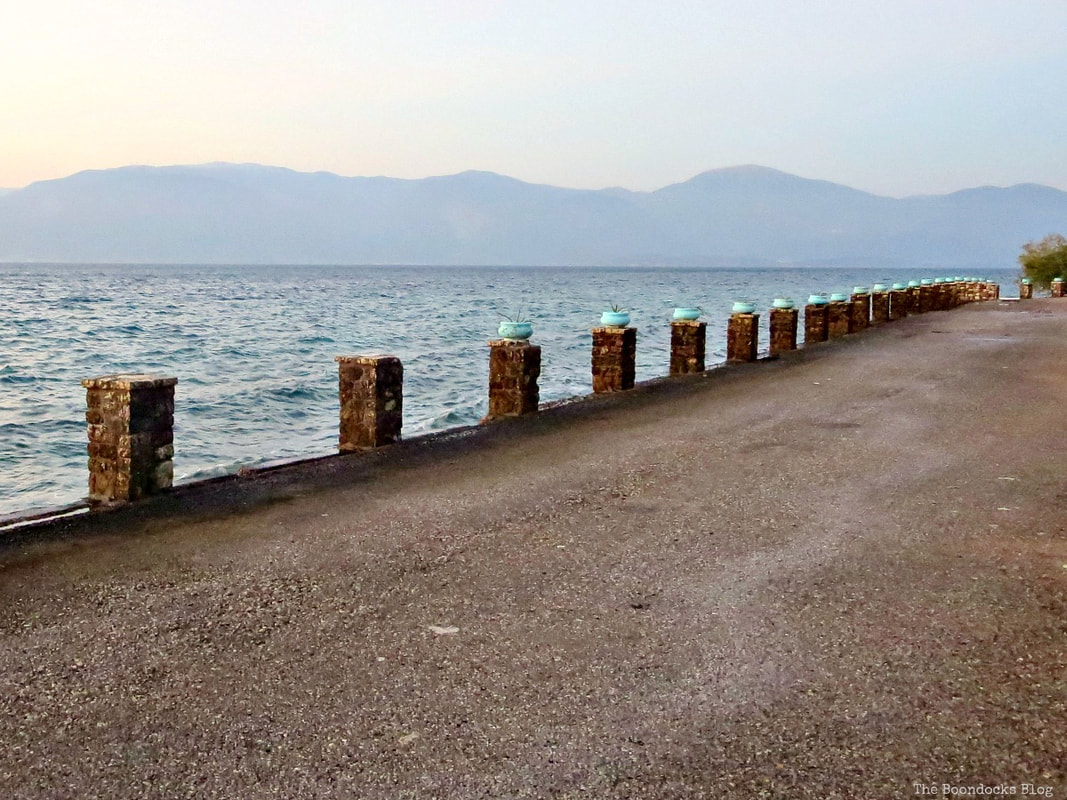 road with pillars near beach, A different look at the beach in Beautiful Greece www.theboondocksblog.com