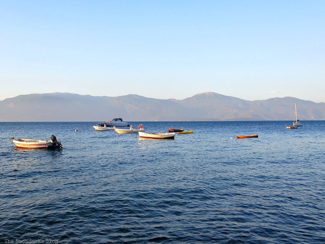 Boats in bay. A different look at the beach in Beautiful Greece www.theboondocksblog.com