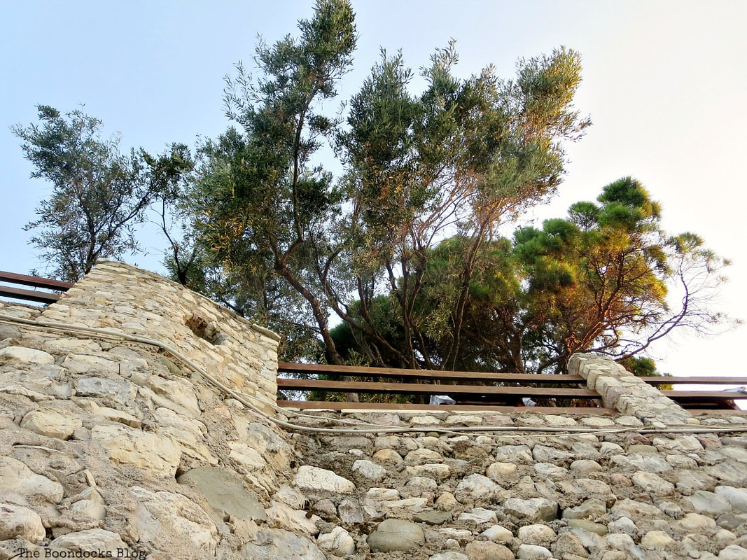 looking up at stone wall, A different look at the beach in Beautiful Greece www.theboondocksblog.com