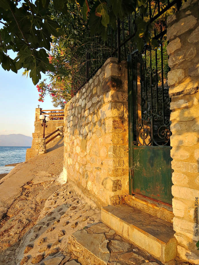 stone wall with gate, A different look at the beach in Beautiful Greece www.theboondocksblog.com