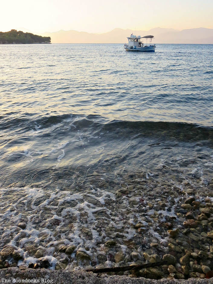 boat in water during sunset, A different look at the beach in Beautiful Greece www.theboondocksblog.com