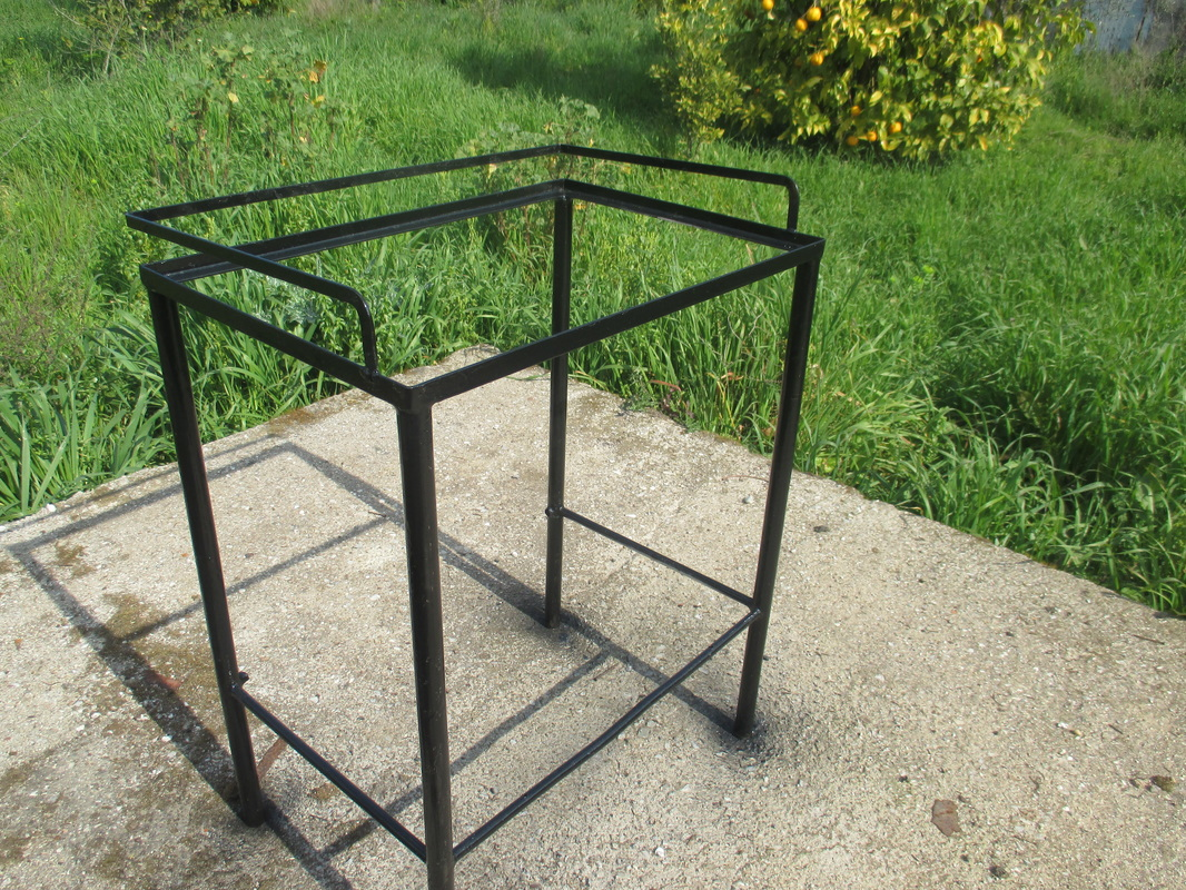 Spray painted black, A rusty old Table Revived www.theboondocksblog.com