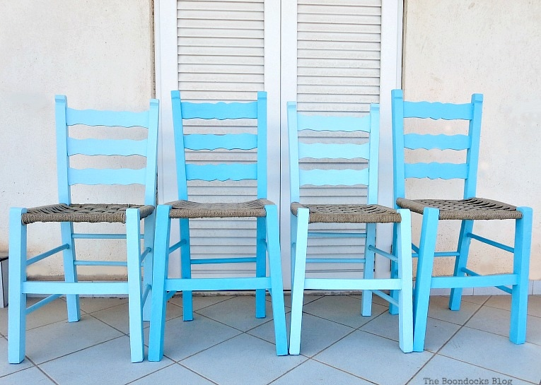 Four chairs painted in blue and light blue, The tale of the Happy Chairs, www.theboondocksblog.com