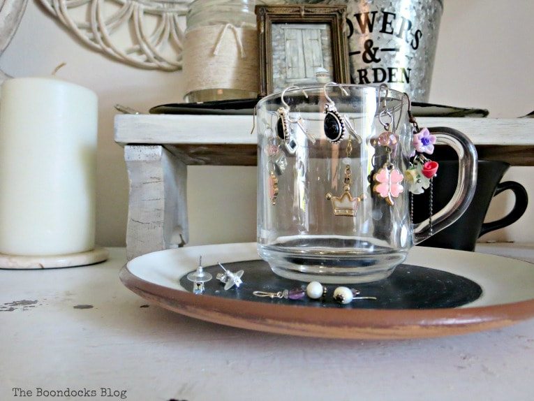 glass cup used to hold drop earrings, #dresser #vintagefurniture #glassknobs #distressedfurniture #bling #shinyknobs How to Make your Dresser Sparkle with Age www.theboondocksblog.com