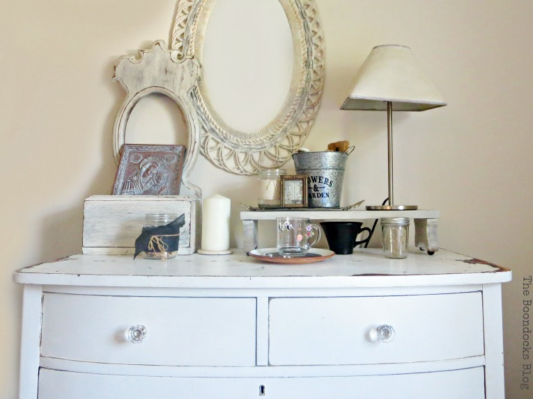 white distressed vintage dresser with glass knobs, #dresser #vintagefurniture #glassknobs #distressedfurniture #bling #shinyknobs How to Make your Dresser Sparkle with Age www.theboondocksblog.com