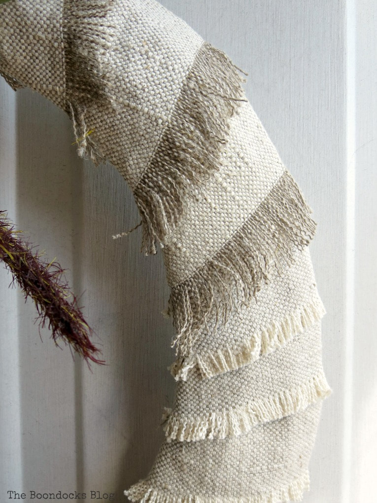 detailed look at frayed edges of fabric strips, How to Make a Simple Dollar Store Fall Wreath www.theboondocksblog.com