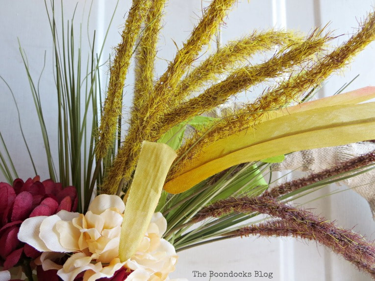 colorful wheat grass, How to Make a Simple Dollar Store Fall Wreath www.theboondocksblog.com