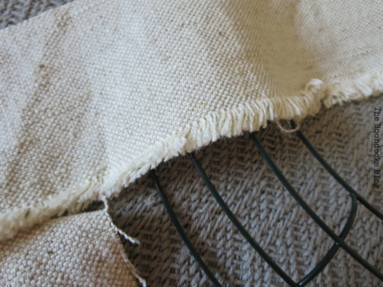 Close up of the frayed edges of strips of fabric.