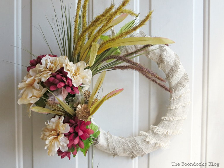 wreath on front door, How to Make a Simple Dollar Store Fall Wreath www.theboondocksblog.com