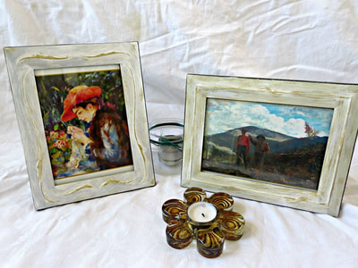 Two painted metal frames