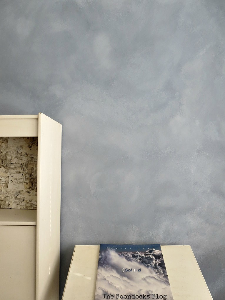 Learn how to paint clouds with a sponge, paint brushes and milk this. The finished accent wall with a cloud effect.
