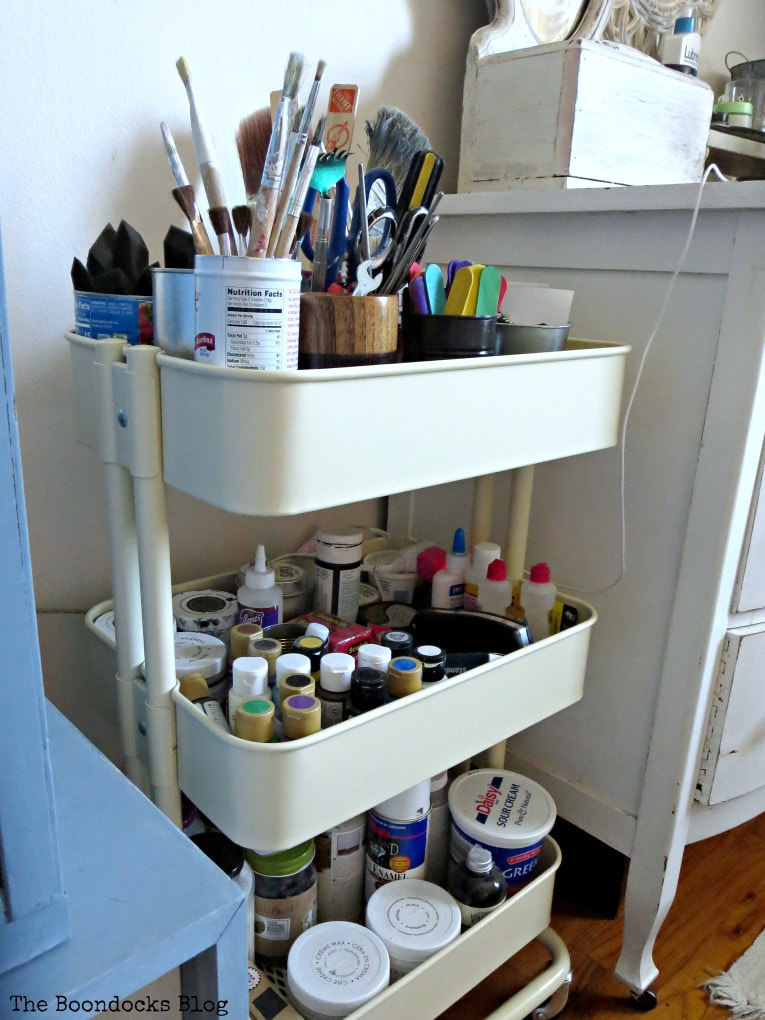 The utility cart full of craft supplies, How to Create a Calm Look for a Bedroom www.theboondocksblog.com