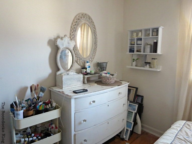 Dresser with mirrors and utility cart, with cubby unit on the wall, How to Create a Calm Look for a Bedroom www.theboondocksblog.com