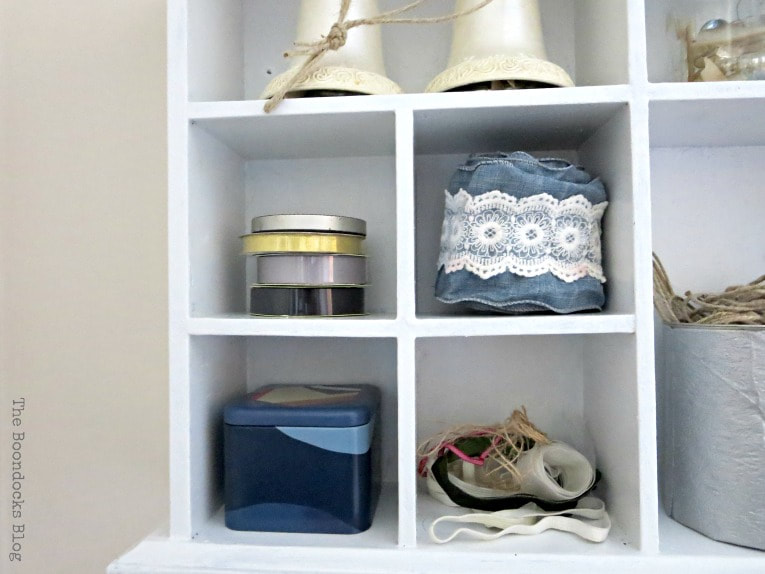 Close up of wall mounted storage caddy, How to Create a Calm Look for a Bedroom www.theboondocksblog.com