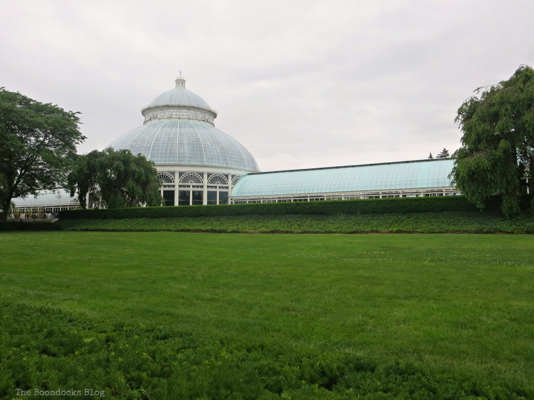 Green lawn with conservatory in background, A Visit to the Remarkable Enid A. Haupt Conservatory www.theboondocksblog.com