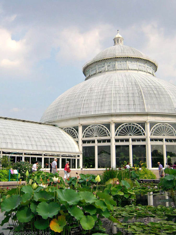 The main dome of the conservatory with the pond in the foreground, #photoessay #photography #NewYorkBotanicalGarden #HauptConservatory #Greenhouse #NewYork A Visit to the Remarkable Enid A. Haupt Conservatory www.theboondocksblog.com