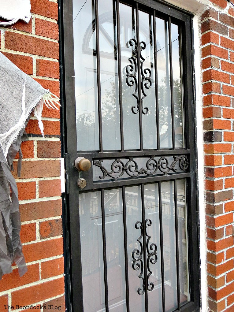 With storm door in front, How to Paint your Front Door for a Sturdy Finish www.theboondocksblog.com