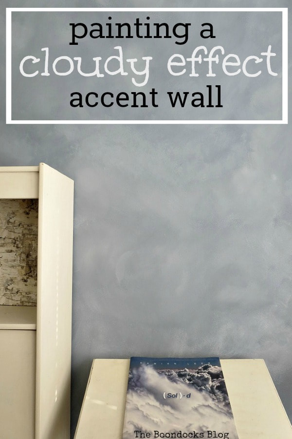"Accent wall with a cloud effect with text overlay ""painting a cloudy effect accent wall."""
