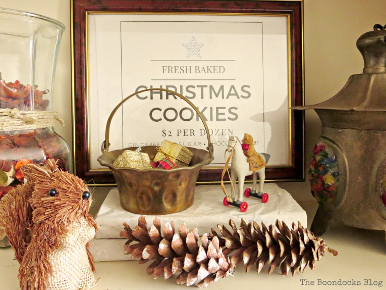 Brown picture frame and brass basket, How to Reuse Old Decor to Make Bright Christmas Vignettes www.theboondocksblog.com