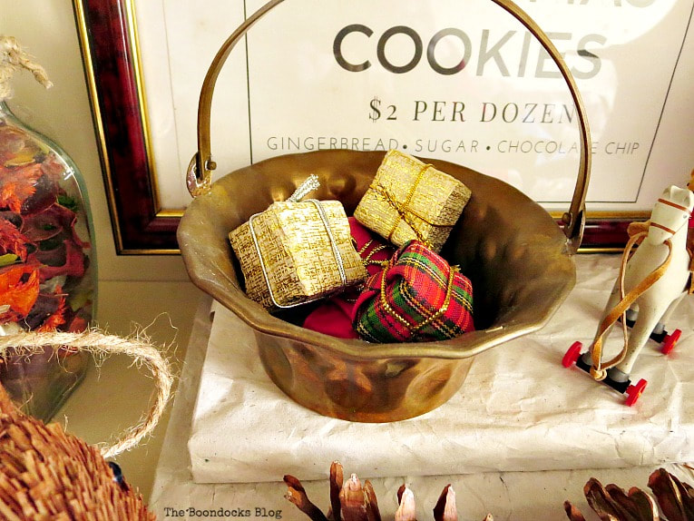 tiny presents inside brass basket, How to Reuse Old Decor to Make Bright Christmas Vignettes www.theboondocksblog.com