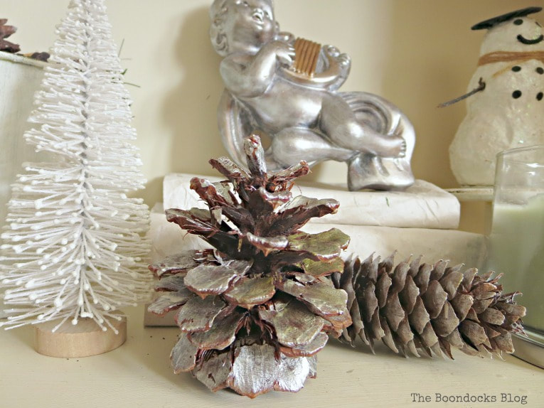 Pine cones painted silver and bottle brush tree, How to Reuse Old Decor to Make Bright Christmas Vignettes www.theboondocksblog.com