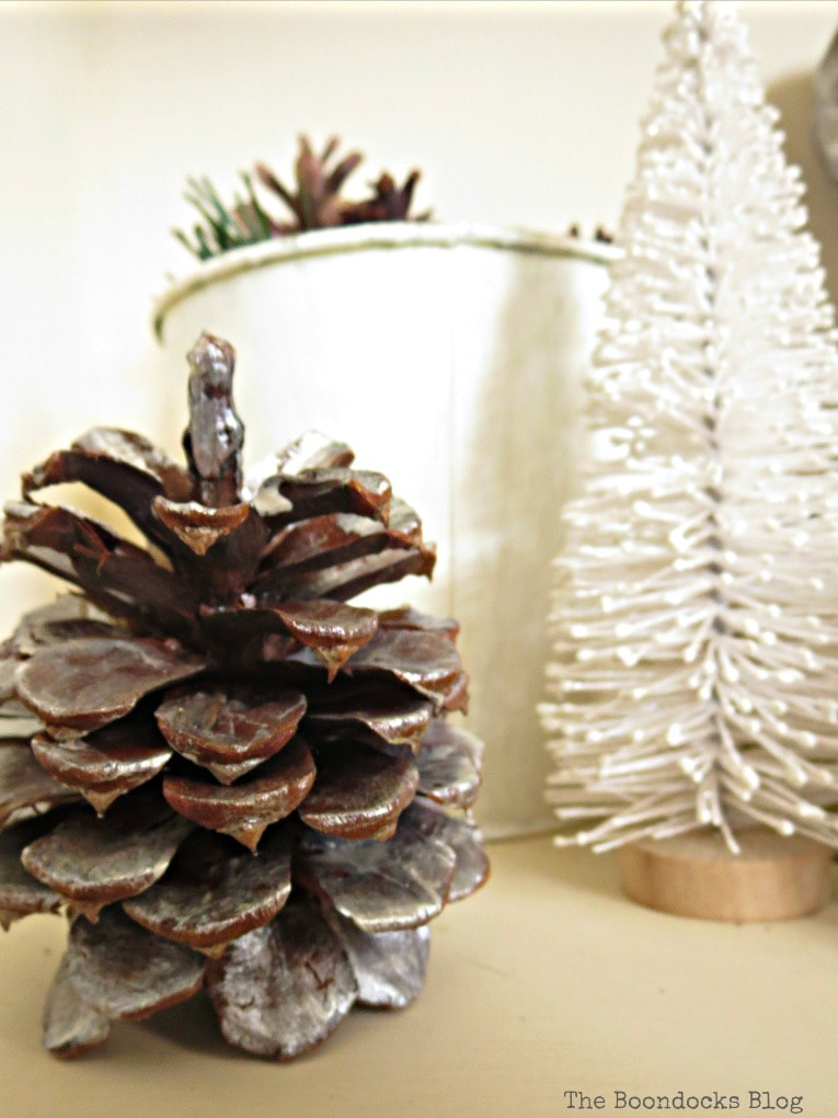 Close up of pine cone, How to Reuse Old Decor to Make Bright Christmas Vignettes www.theboondocksblog.com