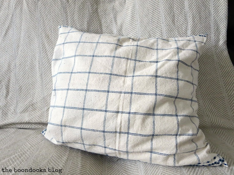 Finished pillow with blue and white check on the other side, How to Make Easy Pillows out of Fabric Remnants 5 ways www.theboondocksblog.com