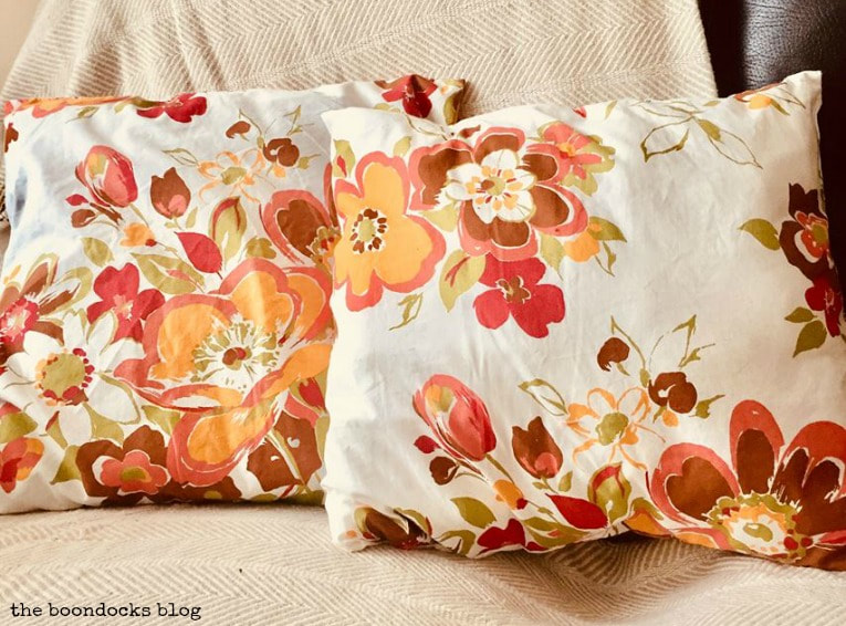 2 fall pillows in warm colors, How to Make Easy Pillows out of Fabric Remnants 5 ways www.theboondocksblog.com