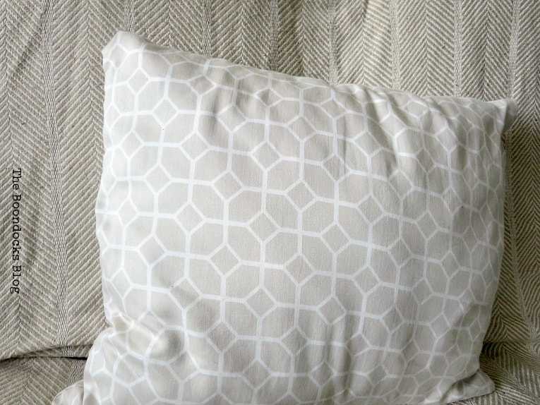 pillow made out of sheet in geometric beige print, How to Make Easy Pillows out of Fabric Remnants 5 ways www.theboondocksblog.com