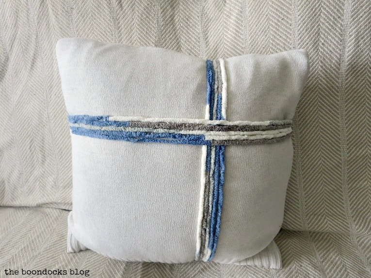 ribbon on sweater pillow made out of yarn, How to Make Easy Pillows out of Fabric Remnants 5 ways www.theboondocksblog.com