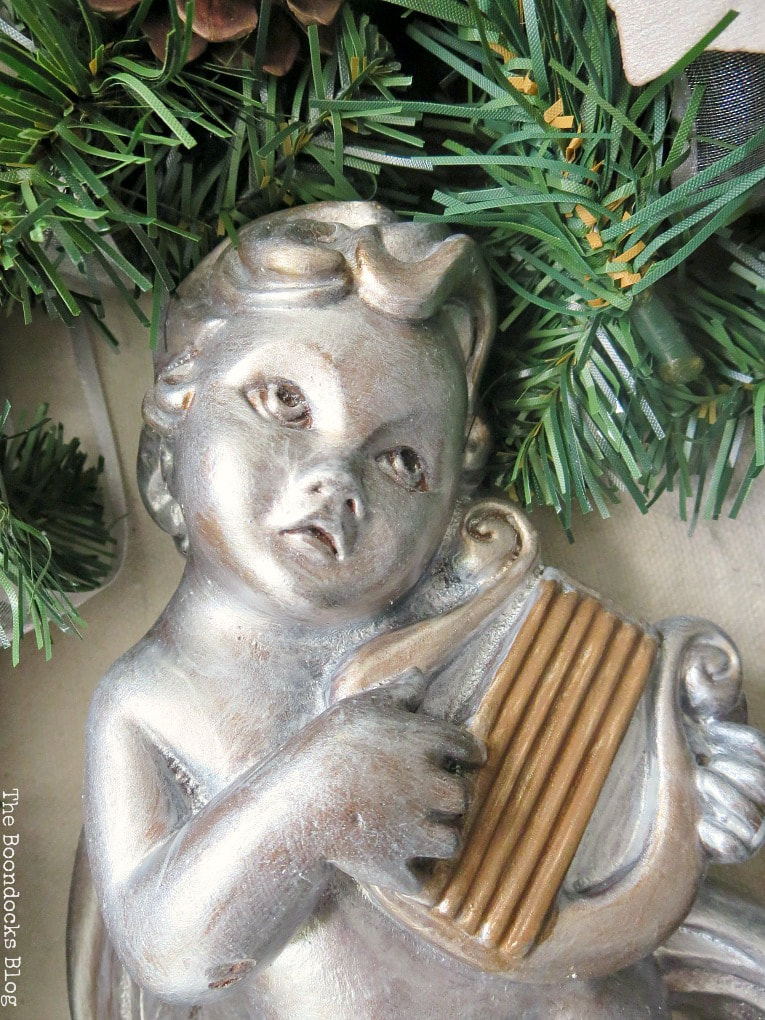 close up of cherub face, How to Make a Christmas Wreath with Metallic Accents, www.theboondocksblog.com