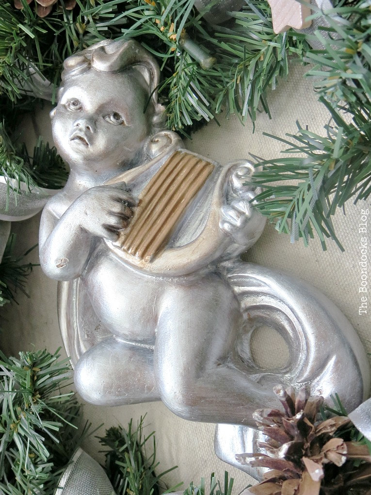 cherub painted in pearl white and harp in metallic brown, How to Make a Christmas Wreath with Metallic Accents, www.theboondocksblog.com