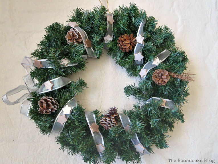 wreath with ribbon and metallic stars, #christmaswreath #upcycle #winterywreath #holidaywreath #metallicaccentwreath #easycraft #christmascraft #holidaycraft #metalliccherub How to Make a Christmas Wreath with Metallic Accents, www.theboondocksblog.com