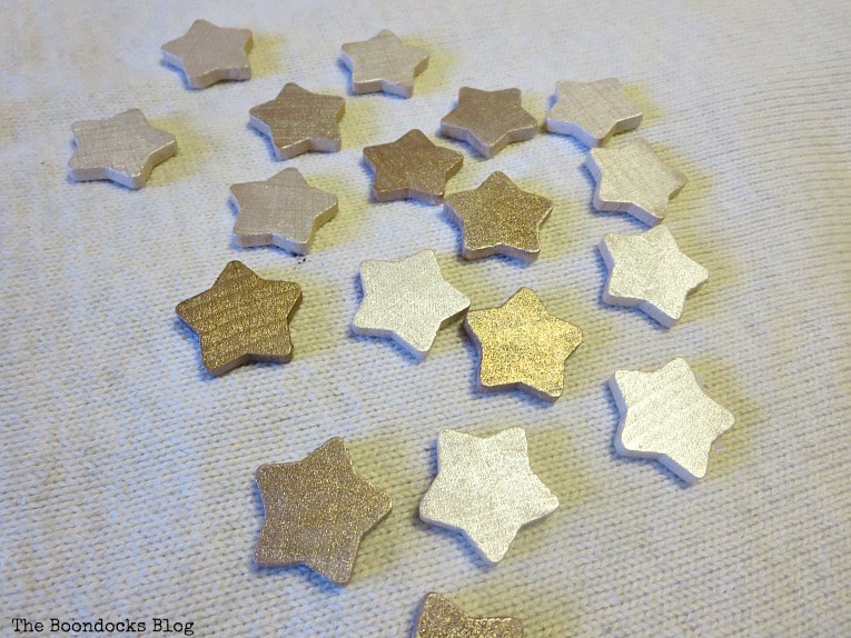 wood stars painted with metallic paint, How to Make a Christmas Wreath with Metallic Accents, www.theboondocksblog.com
