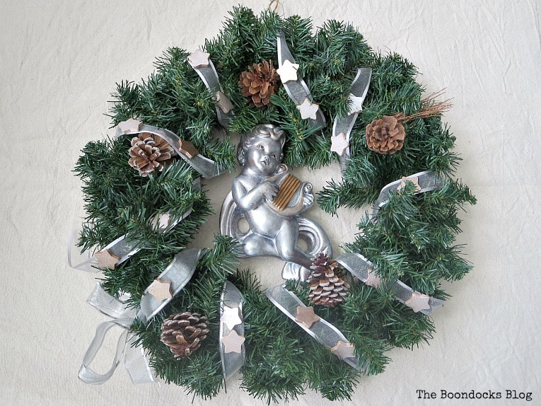 Making a holiday wintery wreath with metallic accents #christmaswreath #upcycle #winterywreath #holidaywreath #metallicaccentwreath #easycraft #christmascraft #holidaycraft #metalliccherub How to Make a Christmas Wreath with Metallic Accents, www.theboondocksblog.com