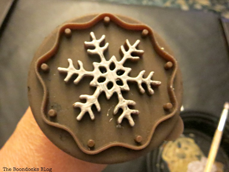 Cookie cutter with paint on, How to Make Easy Snowflake Mini Canvas Ornaments www.theboondocksblog.com