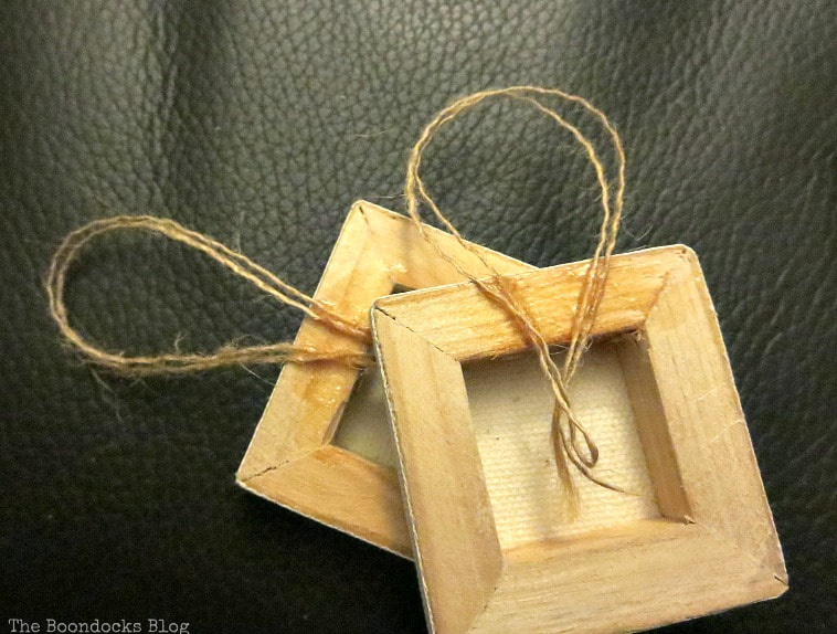 Back of mini canvas with glued on twine, How to Make Easy Snowflake Mini Canvas Ornaments www.theboondocksblog.com