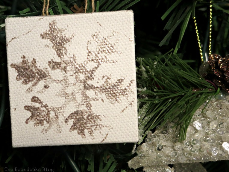 snowflake design on mini canvas on tree, How to Make Easy Snowflake Mini Canvas Ornaments www.theboondocksblog.com