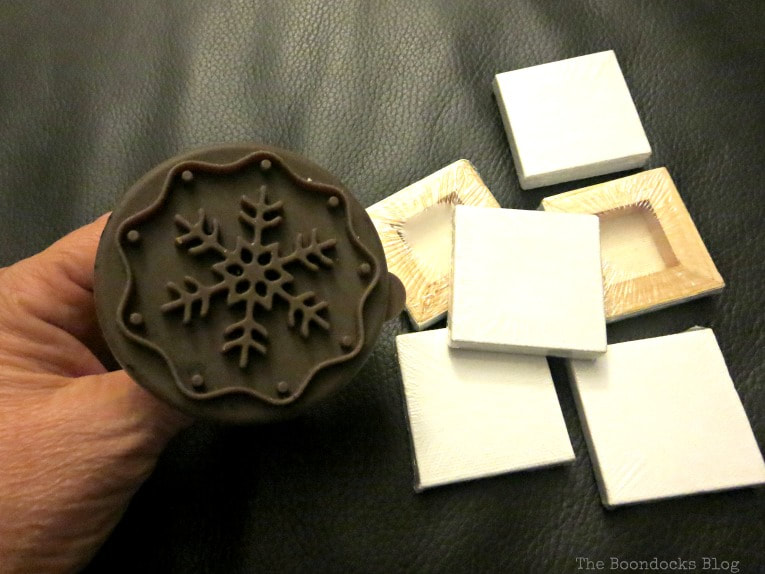 Materials used, mini canvas and cookie cutter, How to Make Easy Snowflake Mini Canvas Ornaments www.theboondocksblog.com