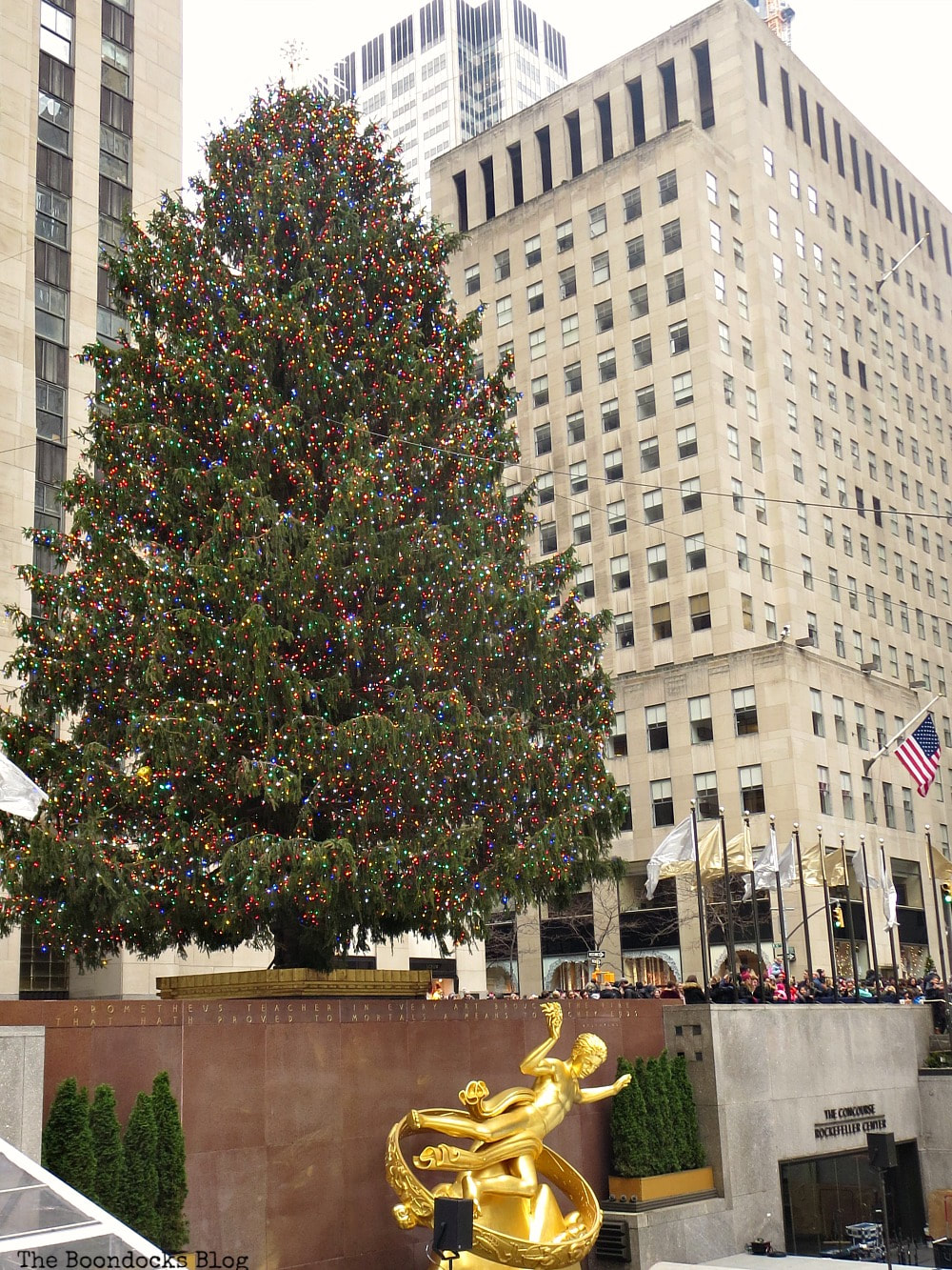 The Christmas tree towering over the Prometheus statue at Rockefeller center, #newyork #photoessay #photography #rockefellercenter #Christmastree #prometheusstatue #Christmasmood A Visit to the Spectacular Tree at Rockefeller Center www.theboondocksblog.com