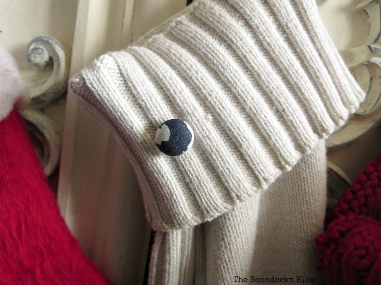 black and white button on white stocking, How to Make Easy Christmas Stockings from Sweaters www.theboondocksblog.com