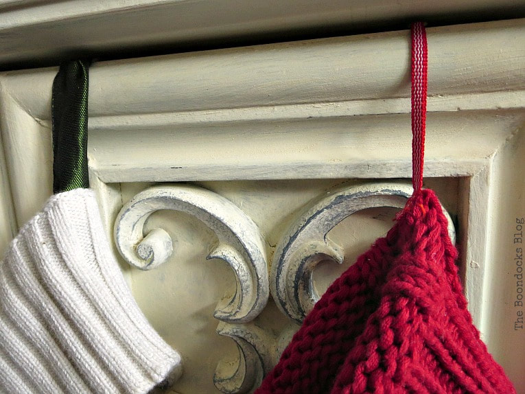 adding ribbons on the top. How to Make Easy Christmas Stockings from Sweaters www.theboondocksblog.com