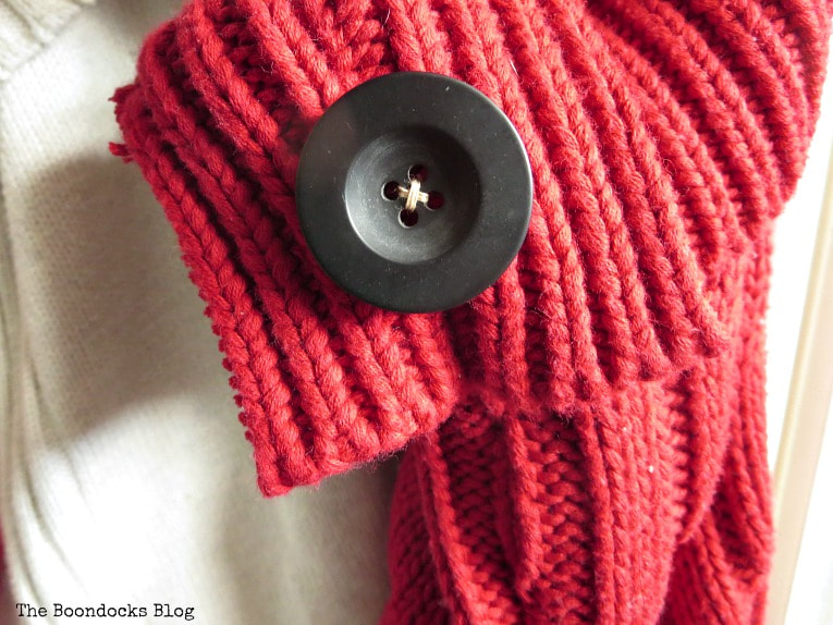 black button on the red stocking, How to Make Easy Christmas Stockings from Sweaters www.theboondocksblog.com
