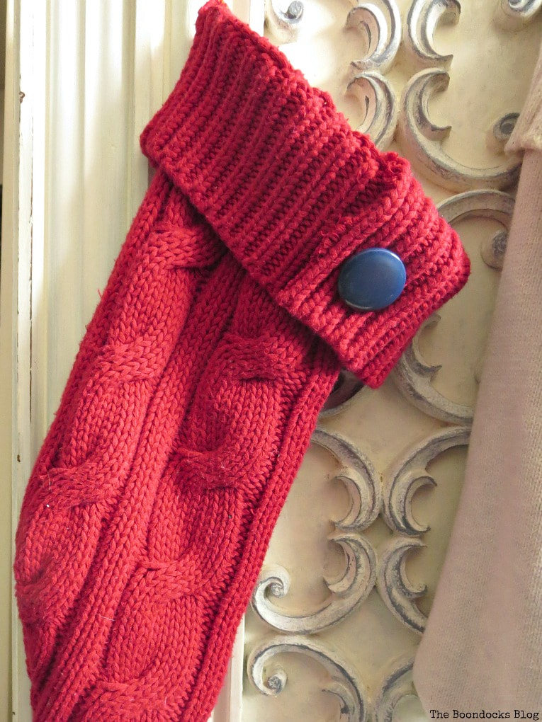 blue button on other red stocking, How to Make Easy Christmas Stockings from Sweaters www.theboondocksblog.com