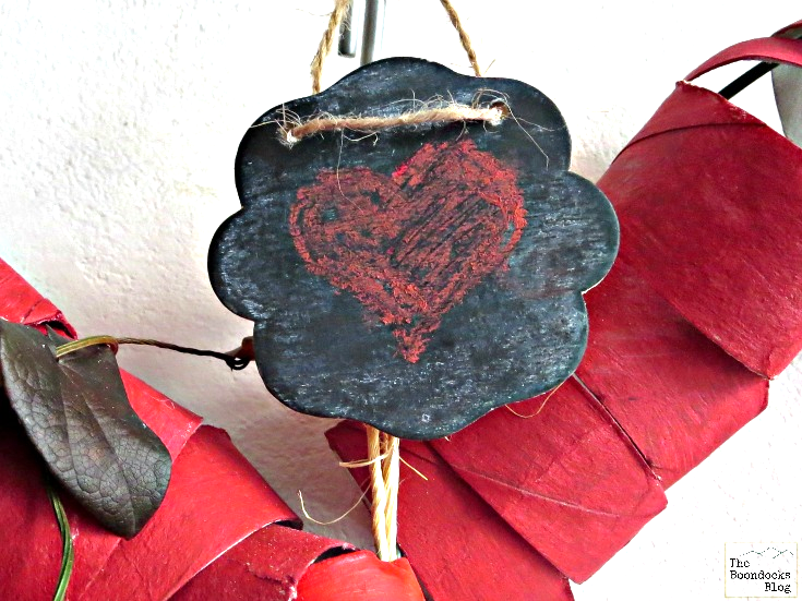 A mini-chalkboard sign added to the top of the heart wreath.