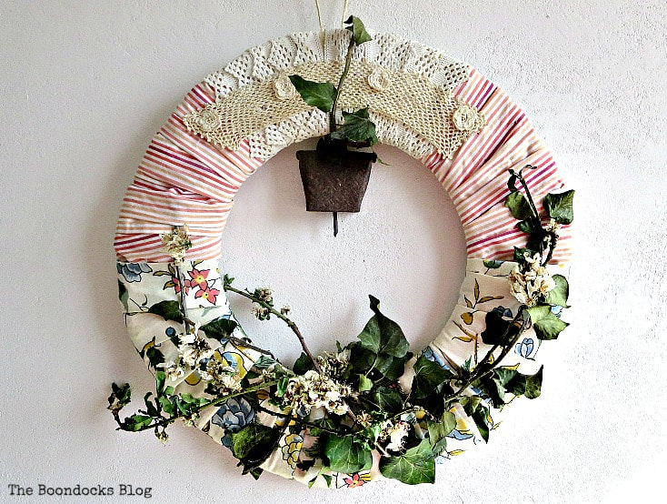 Re-purposed dress collar as embellishment for wreath, 15 Ways to Re-purpose Old Clothes into Something New www.theboondocksblog.com