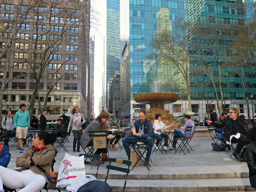 Memorial Fountain surrounded by people and movable chairs, on the west side of Bryant Park, New York, A Visit to the Restored Bryant Park and its Surrounding Areas www.theboondocksblog.com
