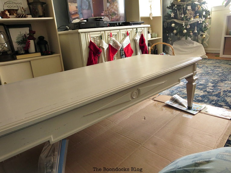After finishing with the beige paint, How to Re-Invent your Old Coffee Table With Paint www.theboondocksblog.com